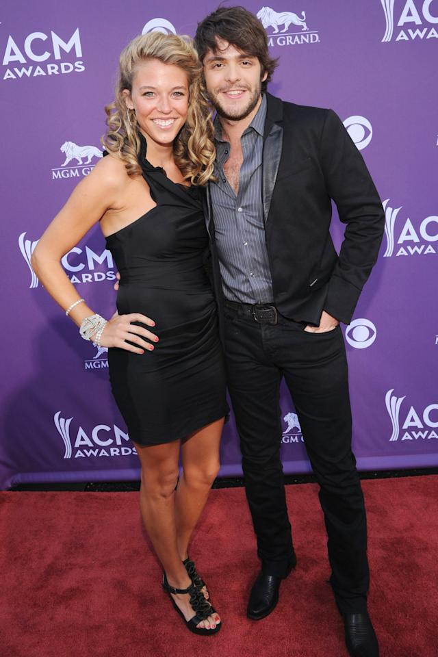 "<p>Up for entertainer of the year, Thomas Rhett posed alongside<a href=""https://people.com/country/inside-thomas-rhett-wife-laurens-sweet-love-story/""> wife Lauren Akins</a> in 2012, looking super cute in coordinated black looks.</p> <p>This was the year the two <a href=""https://people.com/country/thomas-rhett-anniversary-tribute-pregnant-wife-lauren/"">tied the knot</a>, and now they are <a href=""https://people.com/parents/thomas-rhett-calls-wife-laura-akins-his-hero/"">parents to three daughters</a>, Willa Gray, Ada James and Lennon Love.</p>"