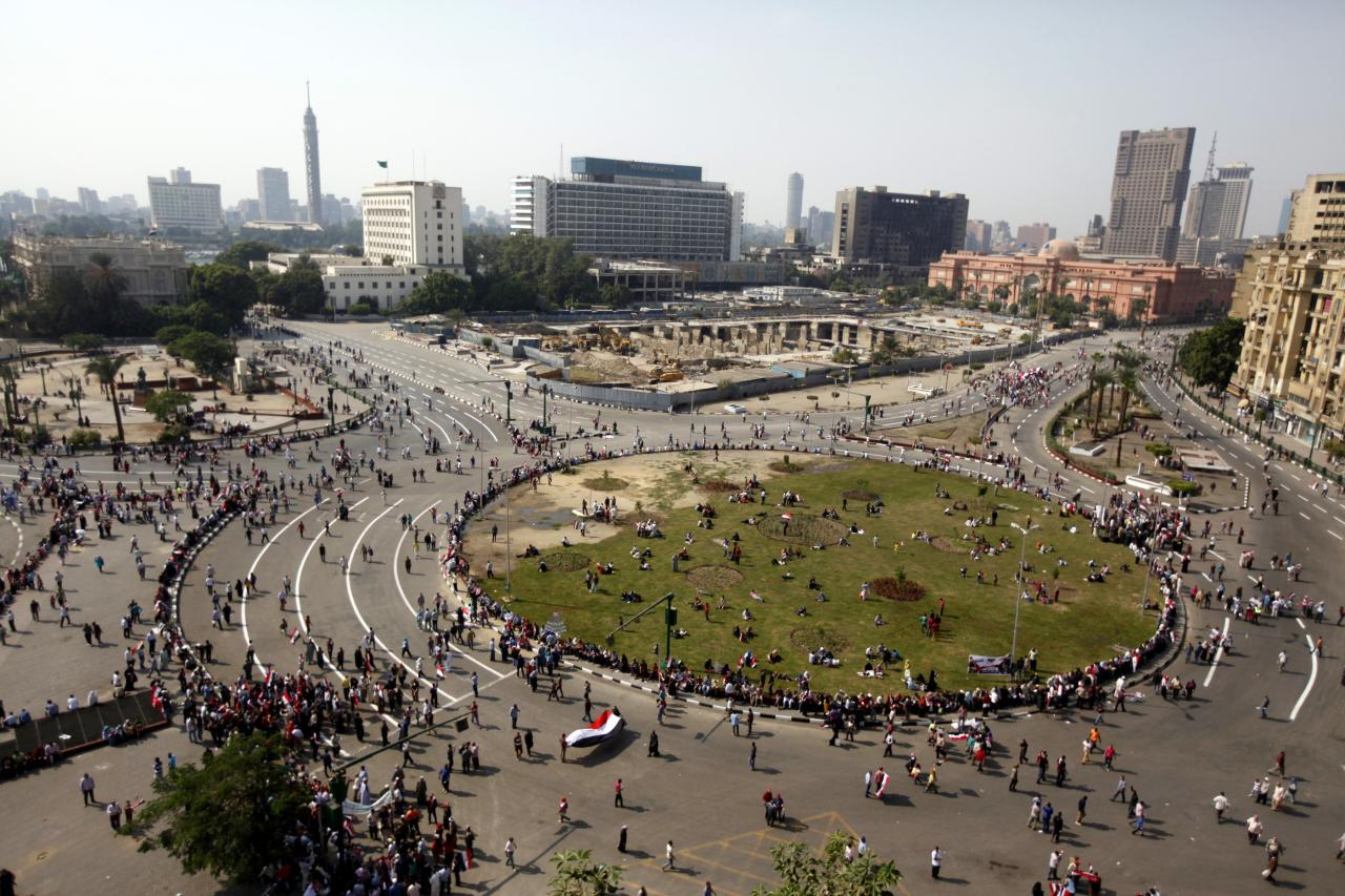 People gather in Tahrir square to celebrate the anniversary of an attack on Israeli forces during the 1973 war, in Cairo October 6, 2013. REUTERS/Mohamed Abd El Ghany (EGYPT - Tags: POLITICS CIVIL UNREST)