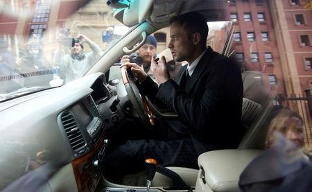 FILE PHOTO: Former Paralympian Oscar Pistorius leaves after the second day of his sentencing for the murder of his girlfriend Reeva Steenkamp, at Pretoria High Court, South Africa June 14, 2016. REUTERS/Siphiwe Sibeko/File Photo