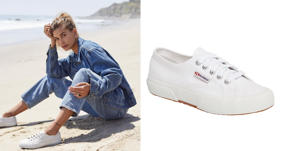 Hailey Bieber sitting on beach in denim jacket and jeans wearing Superga 2750 Cotu Classic Sneakers
