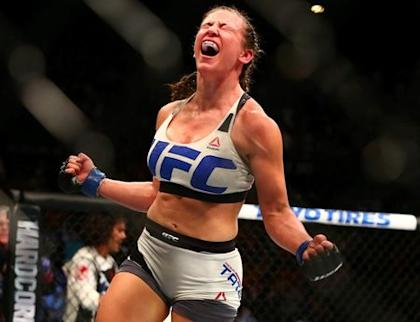 Miesha Tate celebrates her victory by submission against Holly Holm. (Reuters)