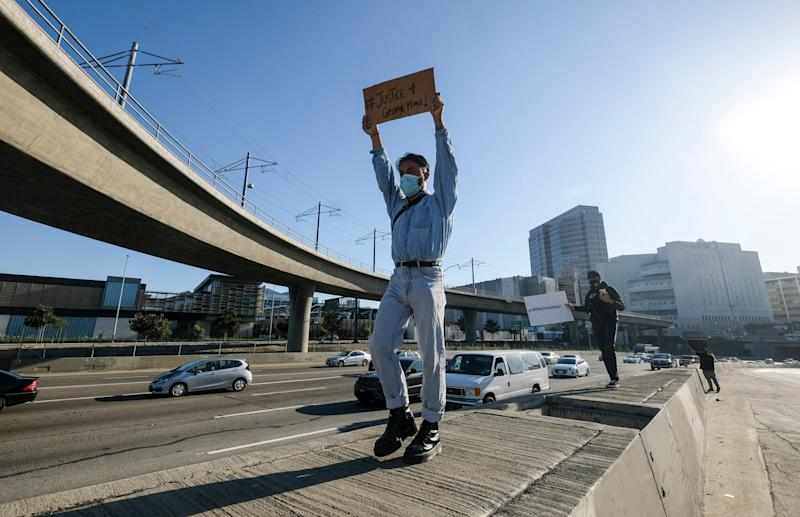 <strong>Demonstrators shut down the Hollywood Freeway in Los Angeles on Wednesday, May 27.</strong> (Photo: ASSOCIATED PRESS)