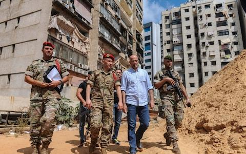Lebanese military intelligence officers inspect the site of the alleged Israeli drone attack in Beirut - Credit: REX/NABIL MOUNZER