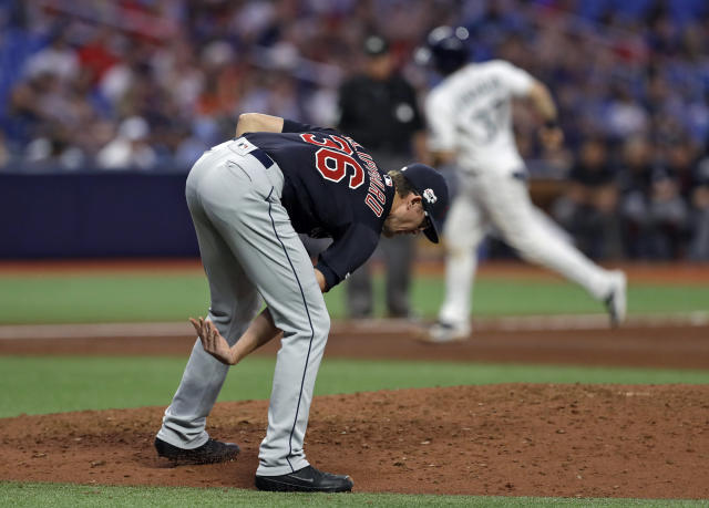 Cleveland Indians relief pitcher Tyler Clippard reacts after giving up a two-run home run to Tampa Bay Rays' Avisail Garcia during the sixth inning of a baseball game Saturday, Aug. 31, 2019, in St. Petersburg, Fla. Running behind Clippard is Rays' Travis d'Arnaud, who scored on Garcia's homer. (AP Photo/Chris O'Meara)