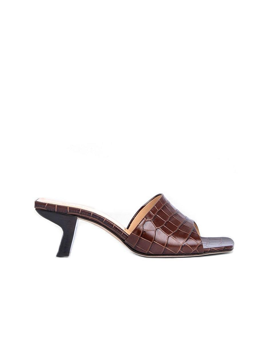 "$290, By Far. <a href=""https://www.byfar.com/collections/mules/products/lily-nutella-croco-embossed-leather?variant=31580306014254"" rel=""nofollow noopener"" target=""_blank"" data-ylk=""slk:Get it now!"" class=""link rapid-noclick-resp"">Get it now!</a>"