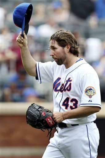 New York Mets starting pitcher R.A. Dickey acknowledges the crowd as he exits during the eighth inning of a baseball game against the San Diego Padres, Sunday, May 27, 2012, at Citi Field in New York. (AP Photo/Seth Wenig)