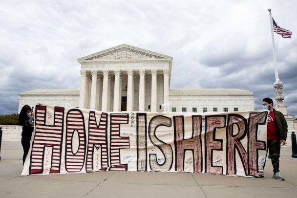 PHOTO: Participants hold a sign that reads 'Home is Here' outside the U.S. Supreme Court as part of a demonstration held by immigration advocates and 'DREAMers' in Washington, April 27, 2020. (Michael Reynolds/EPA via Shutterstock)