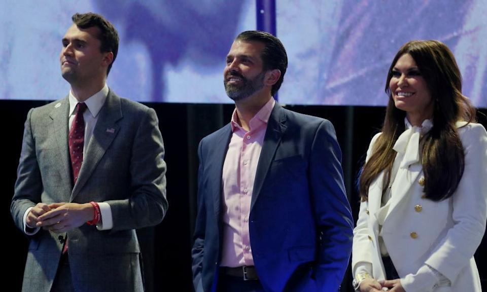 Charlie Kirk, founder of Turning Point USA, left, with Donald Trump Jr and his girlfriend, Kimberly Guilfoyle, at a summit in 2019.