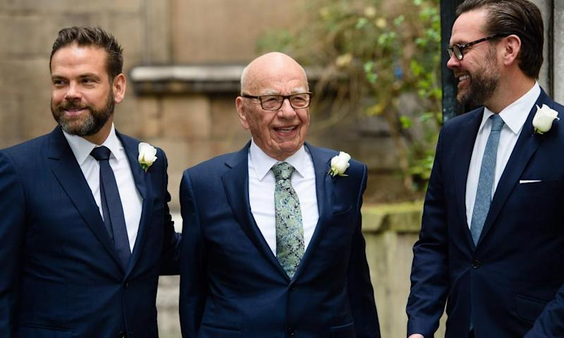 Rupert Murdoch flanked by his sons Lachlan and James on Fleet Street in central London a day after Rupert's marriage to Jerry Hall.