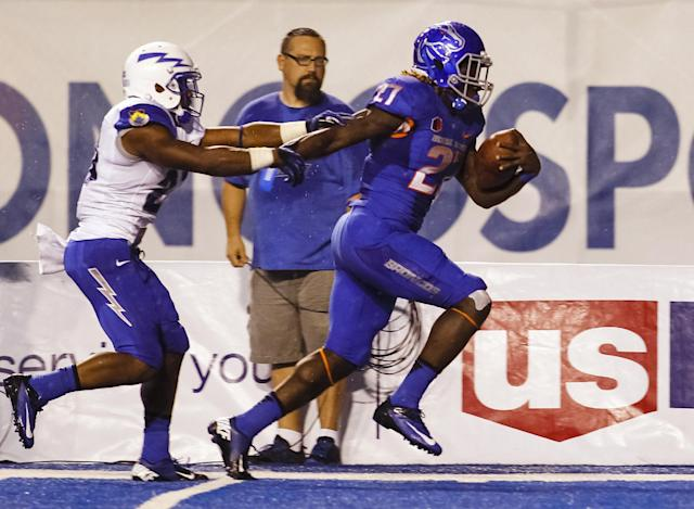 Boise State running back Jay Ajayi (27) runs for a touchdown past Air Force defensive back Christian Spears during the second half of an NCAA college football game in Boise, Idaho, Friday, Sept. 13, 2013. Boise State won 42-20. (AP Photo/Otto Kitsinger)