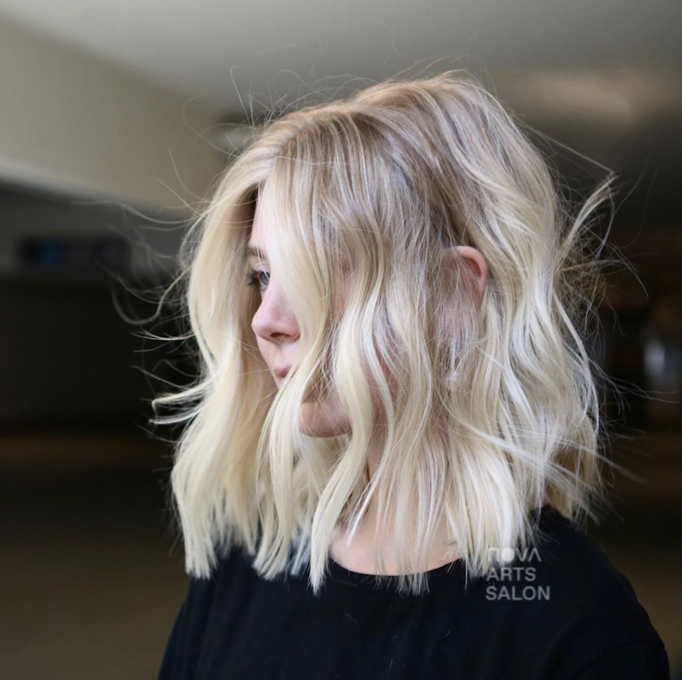 """While this cut looks super dimensional, there's a difference between shattering and classic layers. Per celebrity hairstylist <a href=""""https://www.instagram.com/mattshair/?hl=en"""" rel=""""nofollow noopener"""" target=""""_blank"""" data-ylk=""""slk:Matt Fugate"""" class=""""link rapid-noclick-resp"""">Matt Fugate</a>, just ask your stylist for a """"shattered"""" lob with layers not cut in a straight line but chipped into with a razor. """"The cut is super layered, but don't say <em>layered,</em>"""" he says. That might set your hairstylist down the wrong path, with all the layers falling in the same place (not what you want). Instead, ask for lots of texture with light, airy, razor-cut ends."""
