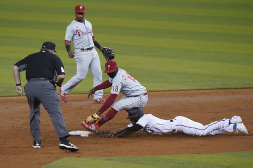 Philadelphia Phillies shortstop Didi Gregorius (18) attempts to tag out Miami Marlins' Starling Marte who advances to second base after Jesus Aguilar flew out during the third inning of a baseball game, Thursday, Sept. 10, 2020, in Miami. (AP Photo/Wilfredo Lee)