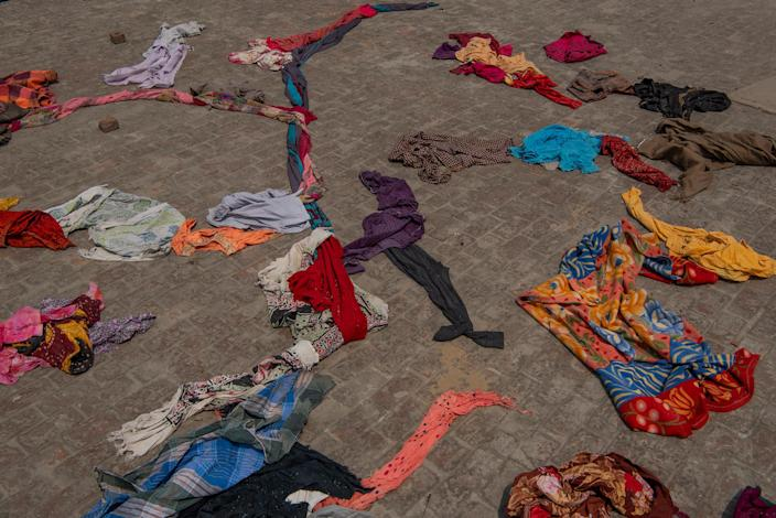 "Clothes of the deceased lie on the terrace of a building within crematorium premises in New Delhi on April 27.<span class=""copyright"">Saumya Khandelwal for TIME</span>"