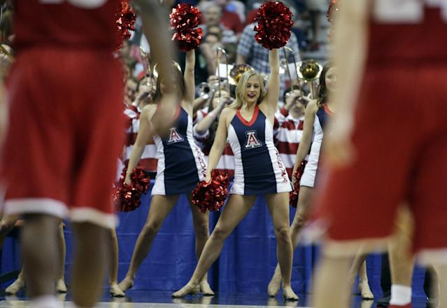 Arizona cheerleaders during the second half in a regional final NCAA college basketball tournament game against Wisconsin, Saturday, March 29, 2014, in Anaheim, Calif. (AP Photo/Alex Gallardo)