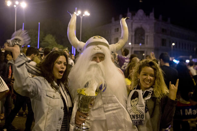 Real Madrid fans celebrate in downtown Madrid, Spain, Sunday, May 27, 2018. Real Madrid defeated Liverpool in Kiev, Ukraine, to win the Champions League soccer match final. (AP Photo/Paul White)