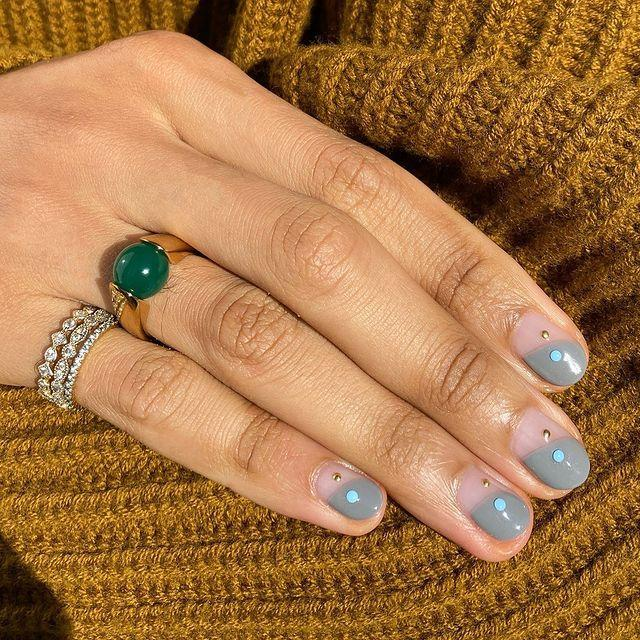 """<p>All you need is a dotting tool and a gem to spice up a simple negative space mani.</p><p><a href=""""https://www.instagram.com/p/CCcHYVnJ-WZ/"""" rel=""""nofollow noopener"""" target=""""_blank"""" data-ylk=""""slk:See the original post on Instagram"""" class=""""link rapid-noclick-resp"""">See the original post on Instagram</a></p>"""