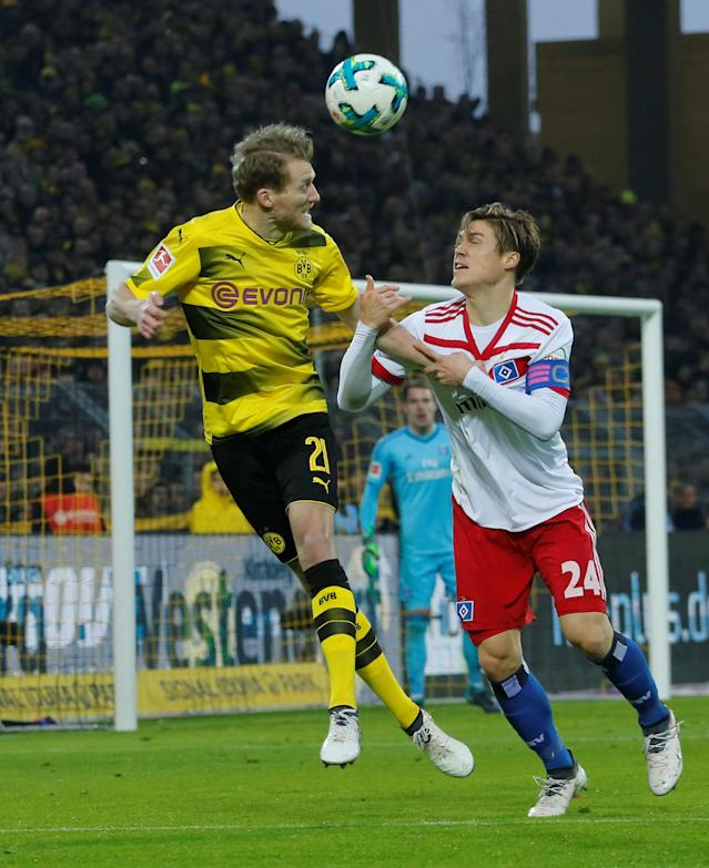 Soccer Football - Bundesliga - Borussia Dortmund vs Hamburger SV - Signal Iduna Park, Dortmund, Germany - February 10, 2018 Borussia Dortmund's Andre Schurrle in action with Hamburg's Gotoku Sakai REUTERS/Leon Kuegeler DFL RULES TO LIMIT THE ONLINE USAGE DURING MATCH TIME TO 15 PICTURES PER GAME. IMAGE SEQUENCES TO SIMULATE VIDEO IS NOT ALLOWED AT ANY TIME. FOR FURTHER QUERIES PLEASE CONTACT DFL DIRECTLY AT + 49 69 650050