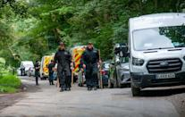 Police officers searching the land at Sand Hutton Gravel Pits near York in connection with the disappearance of missing university chef Claudia Lawrence