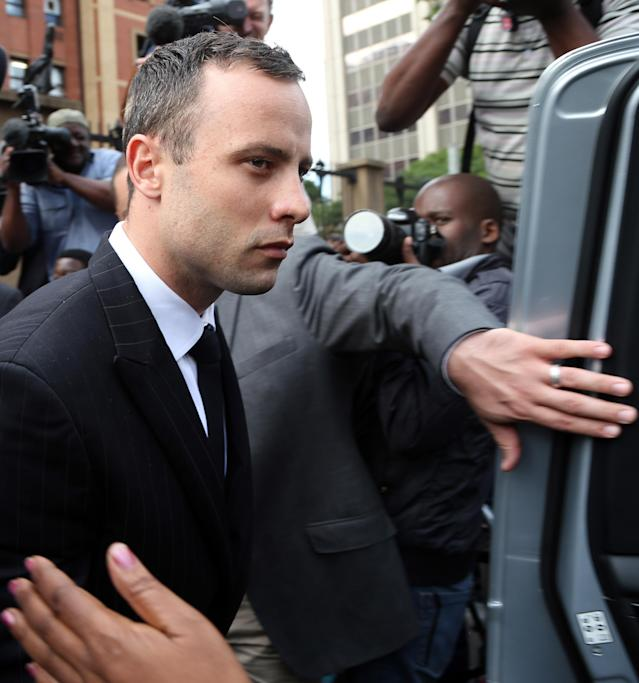 Oscar Pistorius leaves the high court in Pretoria, South Africa, Wednesday, April 9, 2014. Pistorius is charged with murder for the shooting death of his girlfriend, Reeva Steenkamp, on Valentines Day in 2013. (AP Photo/Themba Hadebe)
