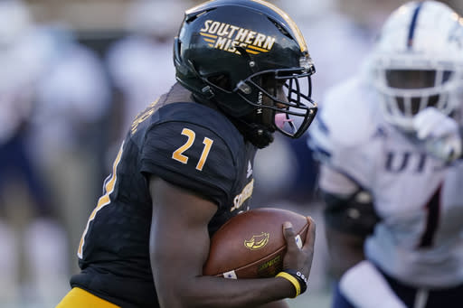 Southern Mississippi running back Frank Gore Jr. (21) carries the ball for a first down against UTSA during the second half of an NCAA college football game, Saturday, Nov. 21, 2020, in Hattiesburg, Miss. UTSA won 23-20. (AP Photo/Rogelio V. Solis)