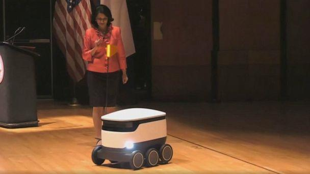 PHOTO: University of Houston President Renu Khator demonstrates an autonomous food delivery robot during her annual fall address, Sept. 2, 2019. (University of Houston via KTRK)