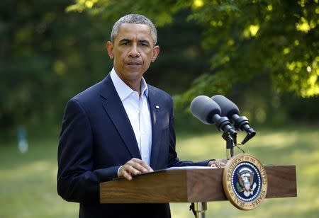 U.S. President Obama delivers a statement on the situation in Iraq from his vacation home at Martha's Vineyard, Massachusetts