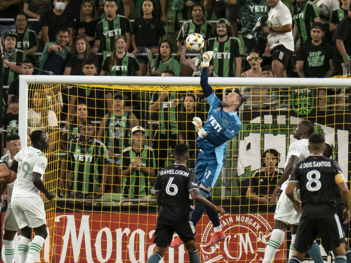Austin FC goalkeeper Brad Stuver goes up for a save during the first half of an MLS soccer match against the LA Galaxy, Sunday, Sept. 26, 2021, in Austin, Texas. (AP Photo/Michael Thomas)