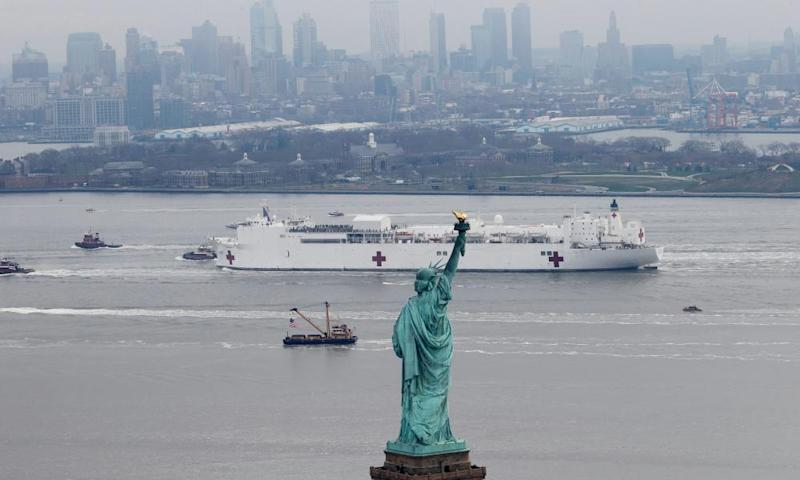 The USNS Comfort passes the Statue of Liberty as it enters New York Harbor on 30 March.