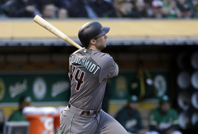 Arizona Diamondbacks' Paul Goldschmidt watches his two-run triple against the Oakland Athletics during the fourth inning of a baseball game Friday, May 25, 2018, in Oakland, Calif. (AP Photo/Marcio Jose Sanchez)