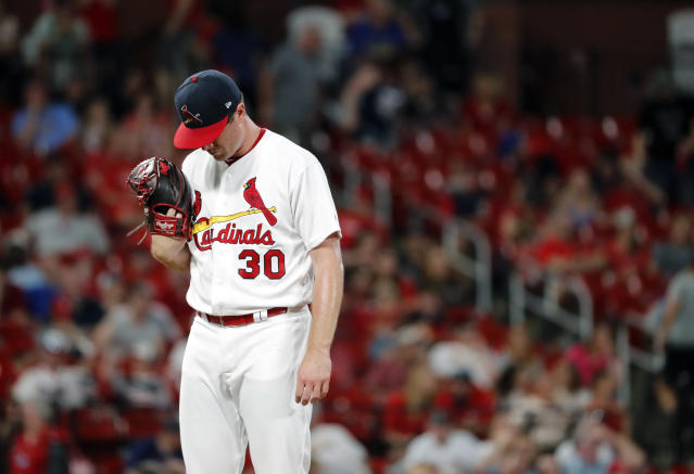 St. Louis Cardinals relief pitcher Tyler Webb waits to be removed after giving up a bases-loaded walk to Atlanta Braves' Brian McCann, scoring Freddie Freeman during the 10th inning of a baseball game, Sunday, May 26, 2019, in St. Louis. (AP Photo/Jeff Roberson)