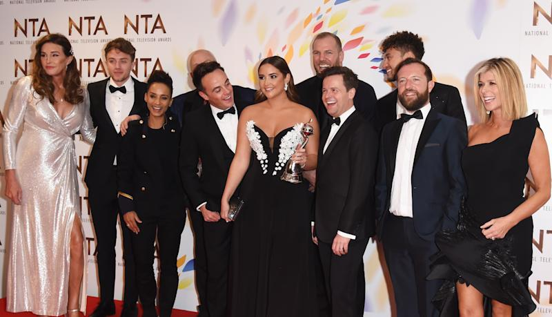 "LONDON, ENGLAND - JANUARY 28: (L to R) Caitlyn Jenner, Roman Kemp, Adele Roberts, Cliff Parisi, Anthony McPartlin, Jacqueline Jossa, James Haskell, Declan Donnelly, Myles Stephenson, Andrew Maxwell and Kate Garraway, accepting the The Bruce Forsyth Entertainment Award for ""I'm A Celebrity... Get Me Out Of Here!"", pose in the winners room at the National Television Awards 2020 at The O2 Arena on January 28, 2020 in London, England. (Photo by David M. Benett/Dave Benett/Getty Images)"