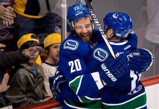 Vancouver Canucks' Chris Higgins, left, and Derek Roy celebrate Higgins' goal against the Edmonton Oilers during the third period of an NHL hockey game Thursday, April 4, 2013, in Vancouver, British Columbia. (AP Photo/The Canadian Press, Darryl Dyck)