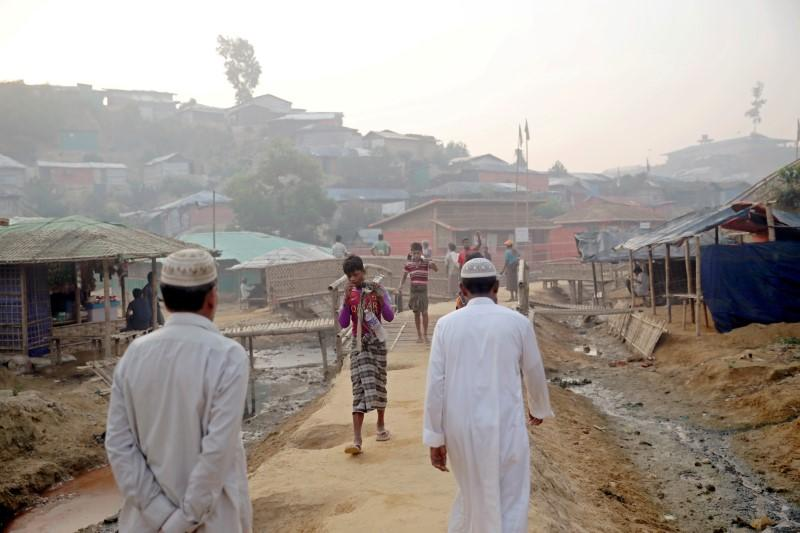 FILE PHOTO: Rohingya refugees walk on a road at the Balukhali camp in Cox's Bazar