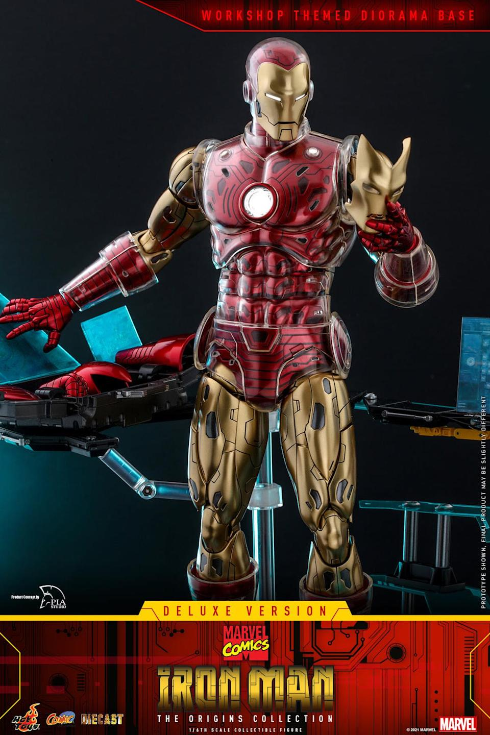 Hot Toys' Iron Man Marvel comics figure standing up and looking at a new mask in his hand