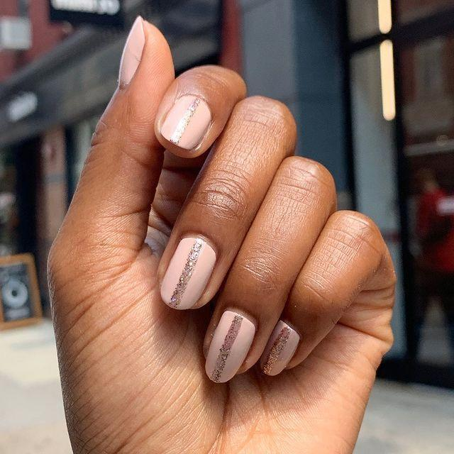 """<p>A chunky glitter stripe down the length of each nail. You'll need some nail tape to get those ruler-sharp edges, but other than that, EASY!</p><p><a href=""""https://www.instagram.com/p/B3n2qr2FyhQ/"""" rel=""""nofollow noopener"""" target=""""_blank"""" data-ylk=""""slk:See the original post on Instagram"""" class=""""link rapid-noclick-resp"""">See the original post on Instagram</a></p>"""
