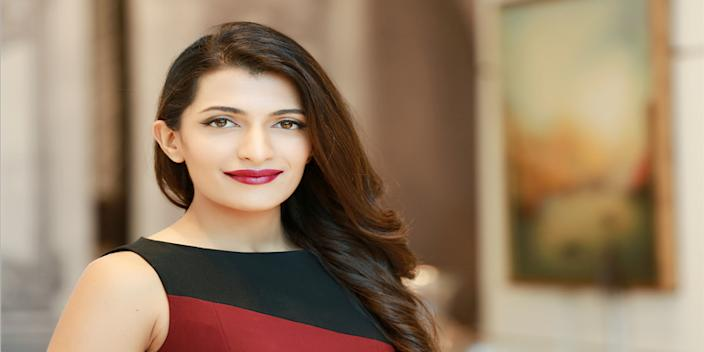 An image of Leeza Mangaldas wearing a black and red dress.