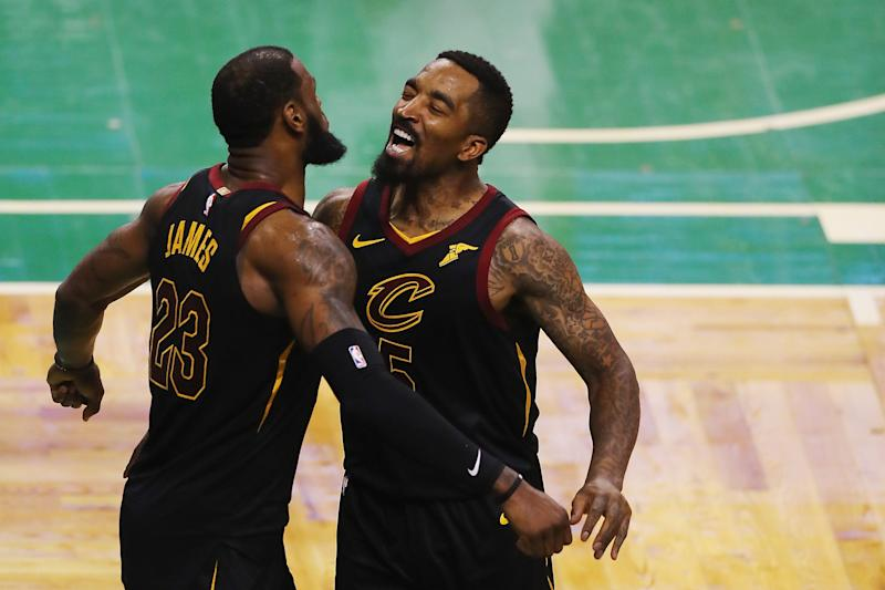 J.R. Smith, right, celebrates a playoff victory in 2018 with LeBron James. (Photo: Adam Glanzman via Getty Images)
