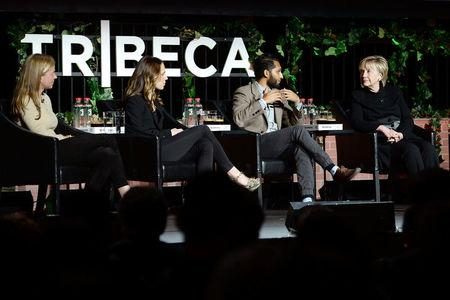 Former U.S. Secretary of State Hillary Clinton (R) joins guests Heydlauf of Africa Parks, Webber, of National Geographic Partners and director and writer Ismail attending Tribeca Film Festival panel discussion in New York