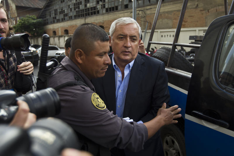 FILE - In this June 13, 2016 file photo, Guatemalan former President Otto Perez Molina is escorted by police into a court hearing in Guatemala City. Molina was imprisoned after the U.N.-sponsored anti-graft commission known as the CICIG, working hand in hand with local prosecutors, brought corruption cases against him. (AP Photo/Moises Castillo, File)