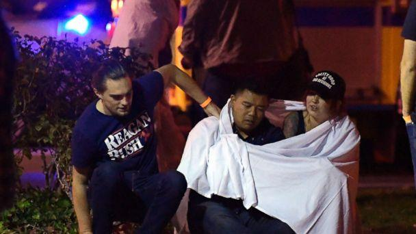 PHOTO: People comfort each other as they sit near the scene, Nov. 8, 2018, in Thousand Oaks, Calif. where a gunman opened fire Wednesday inside a country dance bar crowded with hundreds of people on 'college night.' (Mark J. Terrill/AP)