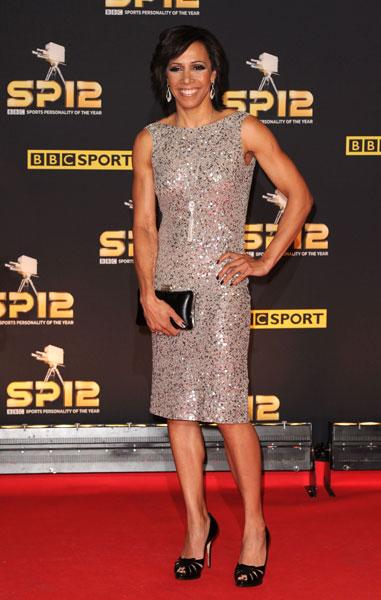 <b>Dame Kelly Holmes </b><br><br>The retired athlete looked stunning in a silver sequinned shift dress and peep toe heels. Smokey eyes completed the look.<br><br>© Rex