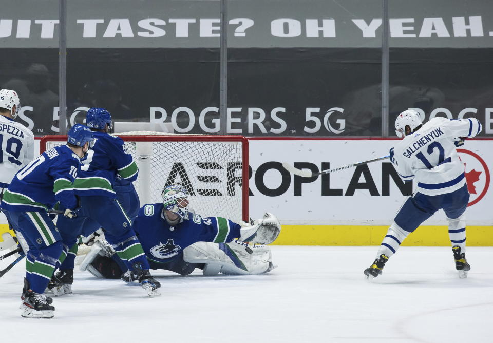 Toronto Maple Leafs' Alex Galchenyuk (12) is stopped by Vancouver Canucks goalie Braden Holtby during the second period of an NHL hockey game in Vancouver, British Columbia, Sunday, April 18, 2021. (Darryl Dyck/The Canadian Press via AP)