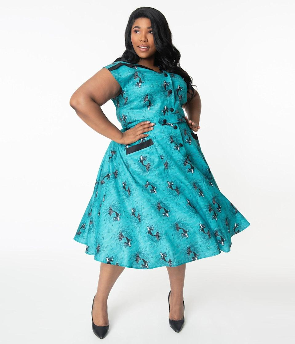 <p>You'll want to dance the night away in this <span>Unique Vintage Plus Size Aqua Vampire Mermaid Print Hedda Swing Dress</span> ($110).</p>