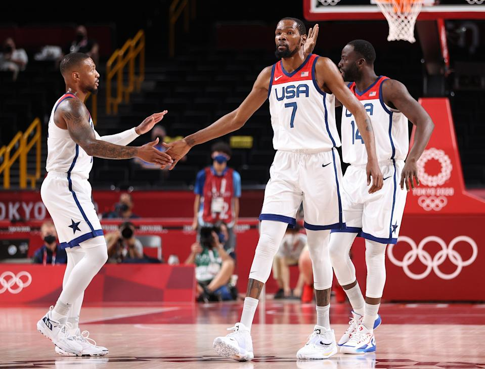 Kevin Durant, left, and Damian Lillard celebrate during the preliminary round victory over Iran on Wednesday.