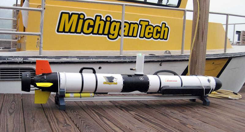 This undated photo proved by Michigan Technological University shows an Iver 3 Autonomous Underwater Vehicle purchased by Enbridge Energy Partners for Michigan Technological University in Houghton, Mich. Michigan Tech's Great Lakes Research Center will use the device to conduct sonar inspections of Enbridge oil pipelines beneath the Straits of Mackinac. Some consider the pipes, laid in 1953, a symbol of the dangers lurking in the nation's sprawling web of buried oil and natural gas pipelines. (AP Photo/Michigan Technological University, Guy Meadows)