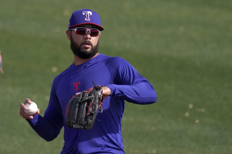 Texas Rangers' Isiah Kiner-Falefa throws during spring training baseball practice Friday, Feb. 26, 2021, in Surprise, Ariz. (AP Photo/Charlie Riedel)