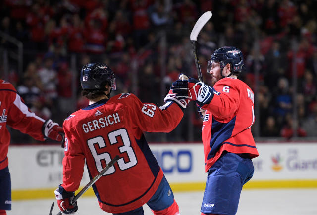 Washington Capitals defenseman Michal Kempny (6) celebrates his goal with left wing Shane Gersich (63) during the second period of an NHL hockey game against the New Jersey Devils, Saturday, April 7, 2018, in Washington. (AP Photo/Nick Wass)