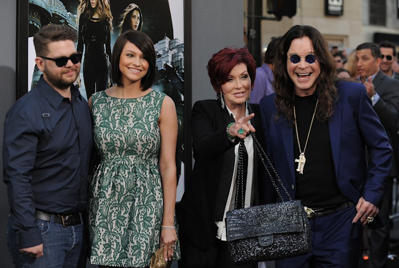 "FILE -- In an Aug. 1, 2012 file photo , from left, Jack Osbourne, Lisa Stelly, Sharon Osbourne and Ozzy Osbourne arrive at the ""Total Recall"" premiere in Los Angeles, Calif.  The ""America's Got Talent"" judge Sharon Osbourne told The New York Post that she's quitting the show because NBC fired her son, Jack Osbourne, by email two days before he was to co-star on the reality show ""Stars Earn Stripes.""  Jack Osbourne, 26, was diagnosed recently with multiple sclerosis.   (Photo by Jordan Strauss/Invision/AP, file)"