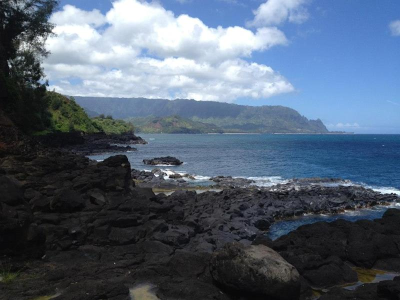 This Aug. 4, 2012 photo shows Queen's Bath on the island of Kauai is pictured in Princeville, Hawaii. Kauai Visitors Bureau Executive Director Sue Kanoho cautions that on any given day, the weather can changes and lead to deaths here by drowning. (AP Photo/Anita Hofschneider)