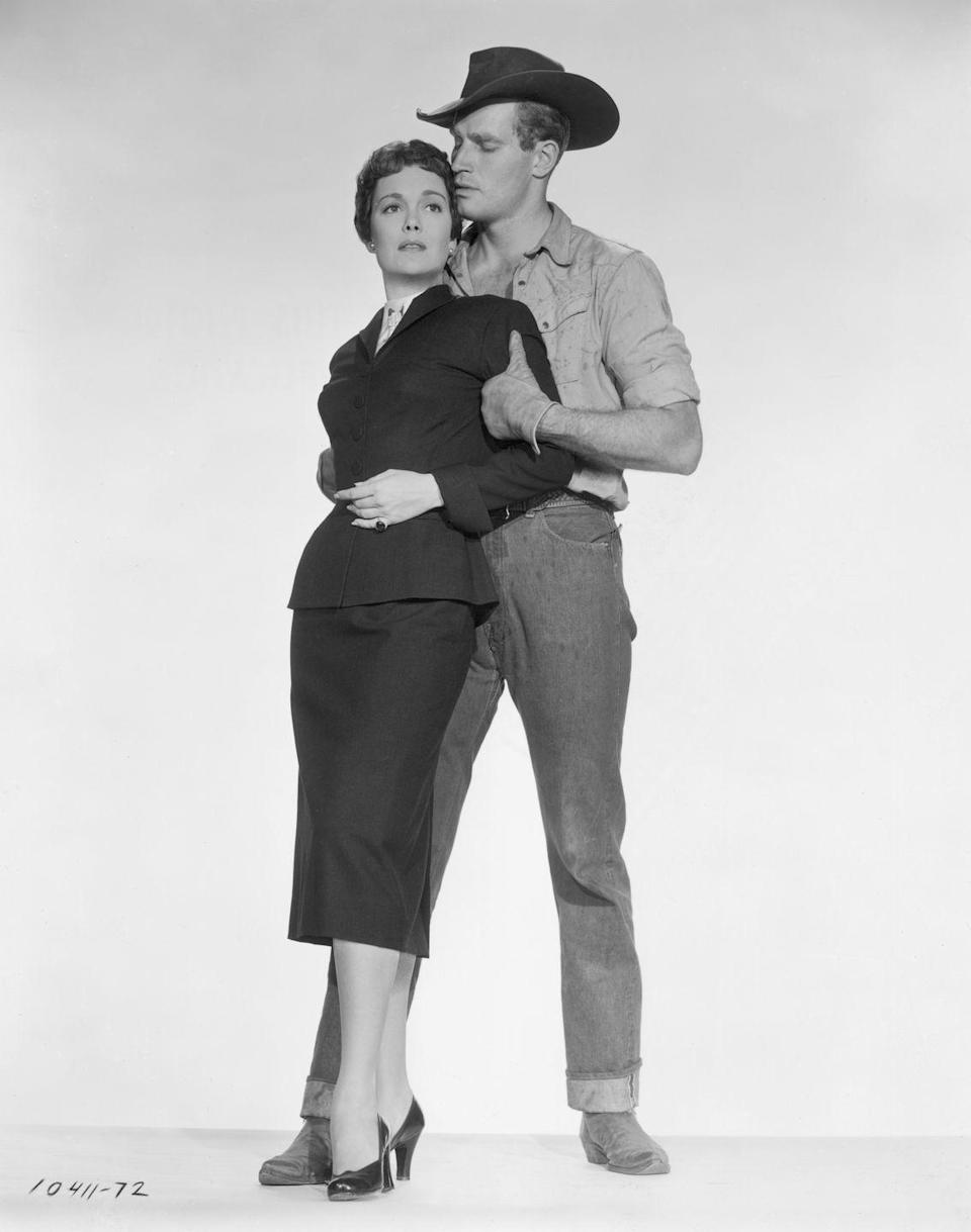 <p>Charlton Heston sported cuffed jeans and cowboy boots in one of his many famous westerns, <em>Lucy Gallant</em>. The actor's denim-clad ensemble was starkly different than his costar Jane Wyman's sleek suit. </p>